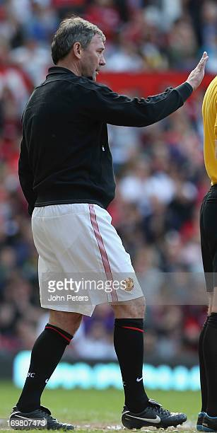 Bryan Robson of Manchester United issues instructions from the touchline at the Manchester United Foundations Legends match between Manchester United...
