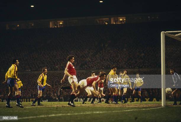 Bryan Robson of Manchester United scores the first goal during the European Cup Winners Cup QuarterFinal Second Leg match between Manchester United...
