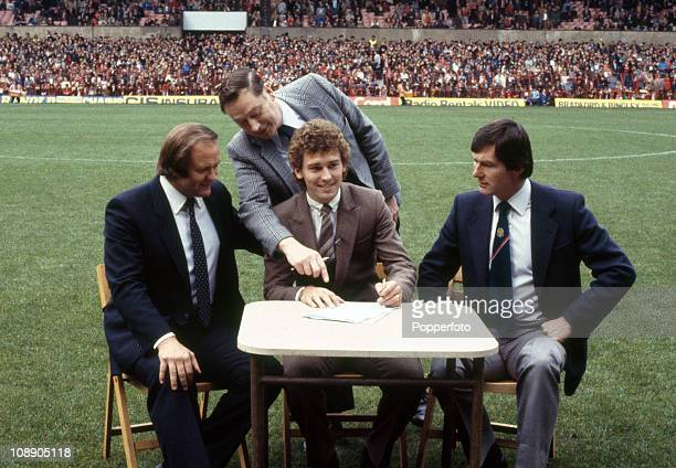 Bryan Robson signs for Manchester United prior to the match against Wolverhampton Wanderers at Old Trafford Manchester on 3rd October 1981 Left to...