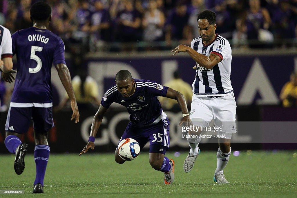 Bryan Rochez of Orlando City and Joleon Lescott of West Bromwich Albion during pre-season friendly between Orlando City and West Bromwich Albion at Orlando Citrus Bowl on July 15, 2015 in Orlando, Florida.