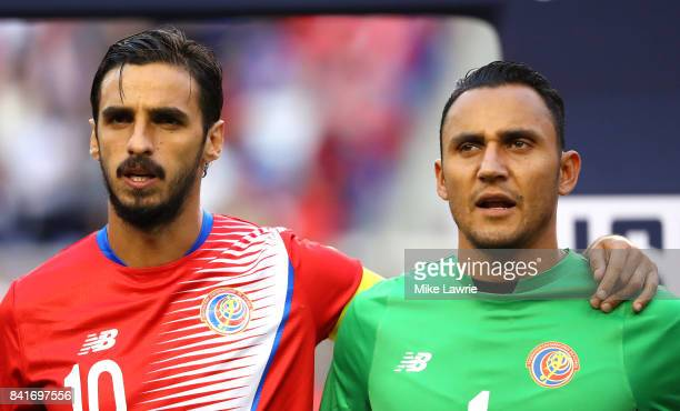 Bryan Ruiz and Keylor Navas of Costa Rica look on during the national anthem before the FIFA 2018 World Cup Qualifier against the United States at...