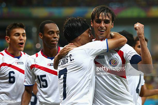 Bryan Ruiz celebrates with Christian Bolanos of Costa Rica scoring his team's first goal during the 2014 FIFA World Cup Brazil Round of 16 match...
