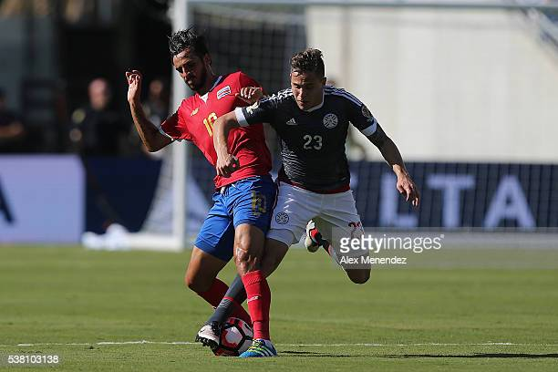Bryan Ruiz of Costa Rica and Robert Piris Da Motta of Paraguay fight for the ball during the 2016 Copa America Centenario Group A match between Costa...
