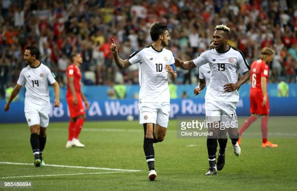 Bryan Ruiz of Costa Rica celebrates with teammate Kendall Waston after scoring a penalty for his team's second goal during the 2018 FIFA World Cup...