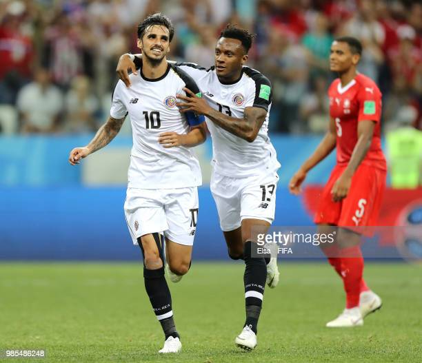 Bryan Ruiz of Costa Rica celebrates with teammate Rodney Wallace after scoring a penalty for his team's second goal during the 2018 FIFA World Cup...
