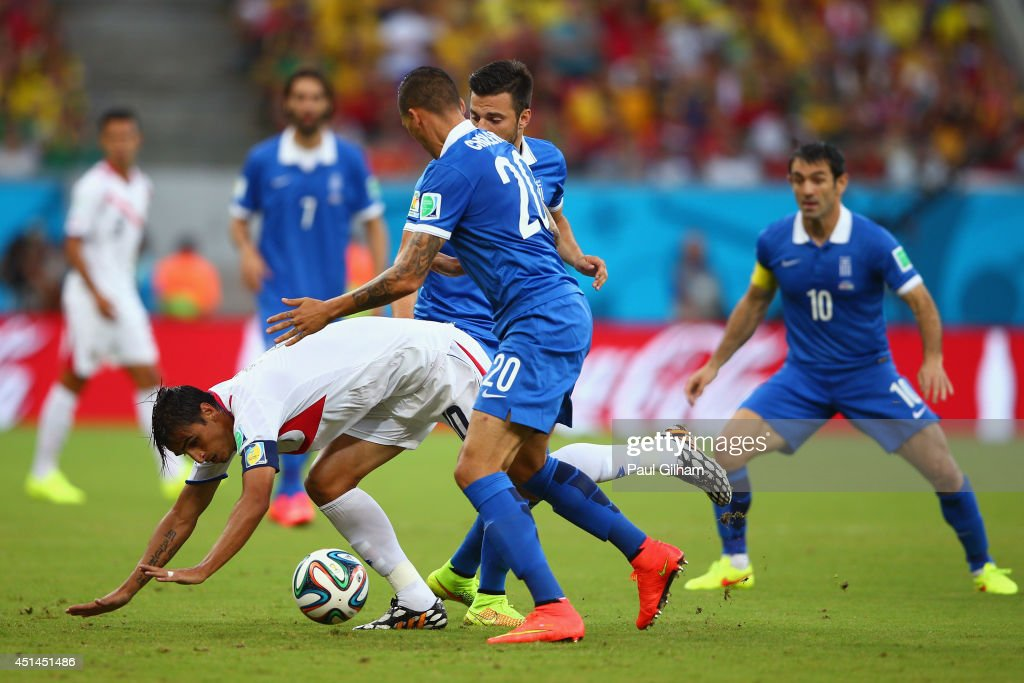 Bryan Ruiz of Costa Rica competes for the ball with Jose Cholevas of Greece during the 2014 FIFA World Cup Brazil Round of 16 match between Costa Rica and Greece at Arena Pernambuco on June 29, 2014 in Recife, Brazil.