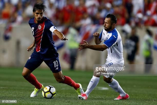 Bryan Ruiz of Costa Rica fights for the ball with Alfredo Mejia of Honduras during their CONCACAF Gold Cup match at Red Bull Arena on July 7, 2017 in...