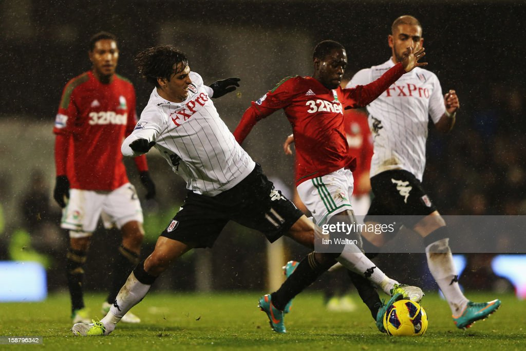 Bryan Ruiz (L) of Fulham and Nathan Dyer (R) of Swansea City challenge for the ball during the Barclays Premier League match between Fulham and Swansea City at Craven Cottage on December 29, 2012 in London, England.