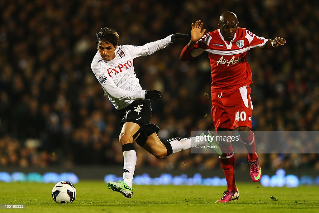 Bryan Ruiz of Fulham is challenged by Stephane Mbia of Queens Park Rangers during the Barclays Premier League match between Fulham and Queens Park Rangers at Craven Cottage on April 1, 2013 in London, England.