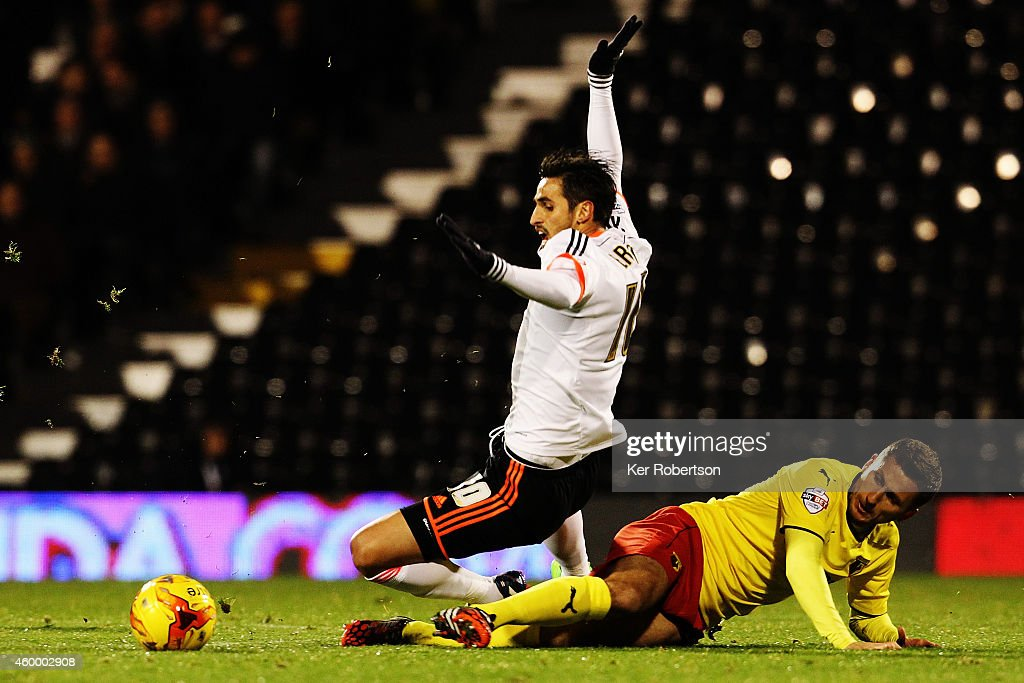 Bryan Ruiz of Fulham is tackled by Almen Abdi of Watford during the Sky Bet Championship match between Fulham and Watford at Craven Cottage on December 5, 2014 in London, England.