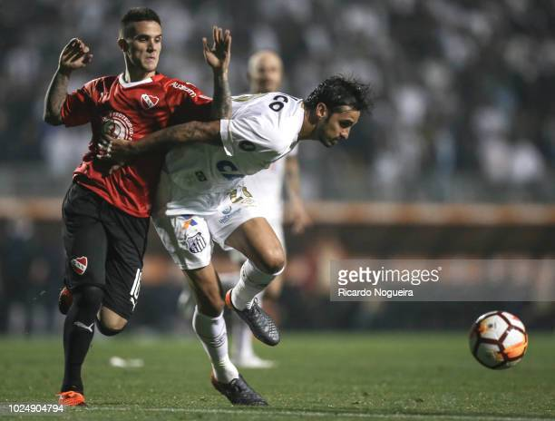 Bryan Ruiz of Santos battles for the ball with Fabricio Bustos of Independiente during the match between Santos and independiente as a part of Copa...