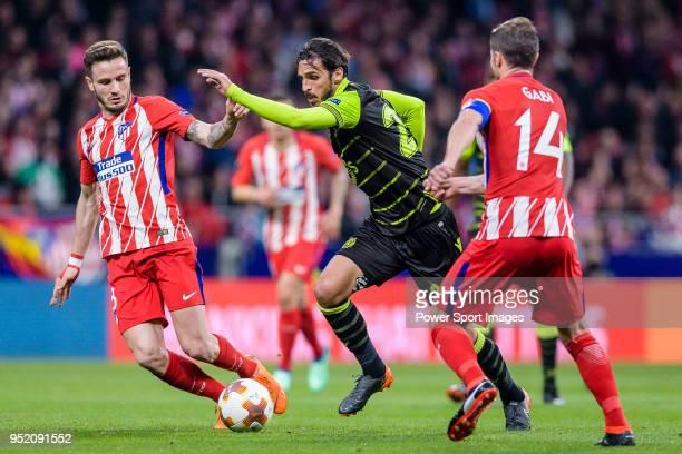 Bryan Ruiz of Sporting CP fights for the ball with Saul Niguez Esclapez of Atletico de Madrid and Gabriel Fernandez Arenas Gabi of Atletico de Madrid...
