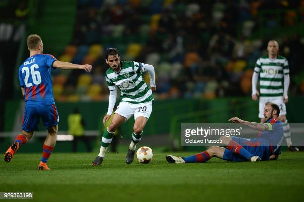 Bryan Ruiz of Sporting Lisbon competes for the ball with Roman Hubnik of Viktoria Plzen during the UEFA Europa League Round of 16 first leg match...