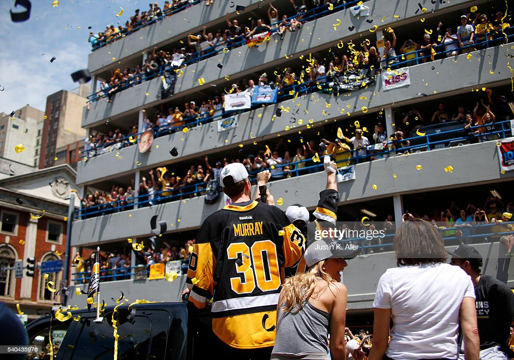 Bryan Rust #17 and Matt Murray #30 of the Pittsburgh Penguins celebrate during the Victory Parade and Rally on June 15, 2016 in Pittsburgh, Pennsylvania. The Penguins defeated the San Jose Sharks to win the NHL Stanley Cup.