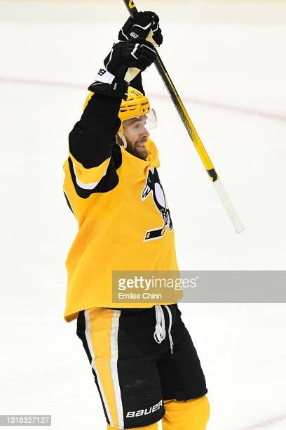 Bryan Rust celebrates a goal by Sidney Crosby of the Pittsburgh Penguins during the second period in Game One of the First Round of the 2021 Stanley...