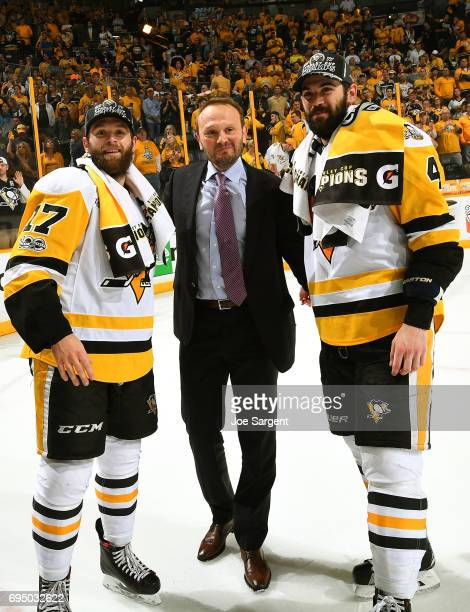 Bryan Rust left and Justin Schultz of the Pittsburgh Penguins pose for a photo on the ice with former Penguins player Sergei Gonchar after Game Six...