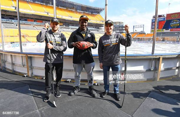 Bryan Rust of the Pittsburgh Penguins Arthur Moats of the Pittsburgh Steelers and Conor Sheary pose for a photo during media availability for the...