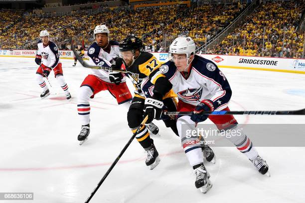Bryan Rust of the Pittsburgh Penguins battles against Seth Jones and Zach Werenski of the Columbus Blue Jackets in Game Two of the Eastern Conference...