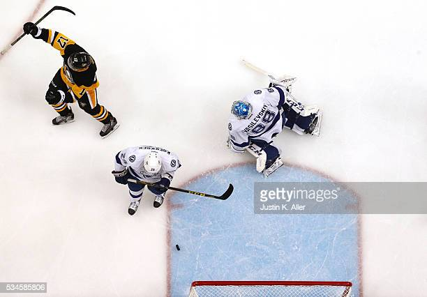 Bryan Rust of the Pittsburgh Penguins celebrates after scoring his first goal against Andrei Vasilevskiy of the Tampa Bay Lightning during the second...