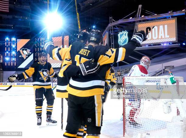 Bryan Rust of the Pittsburgh Penguins celebrates his power play goal scored on goaltender Carey Price of the Montreal Canadiens with teammate Justin...