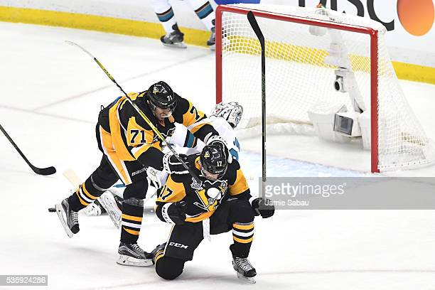 Bryan Rust of the Pittsburgh Penguins celebrates with Evgeni Malkin after scoring a first period goal against the San Jose Sharks in Game One of the...