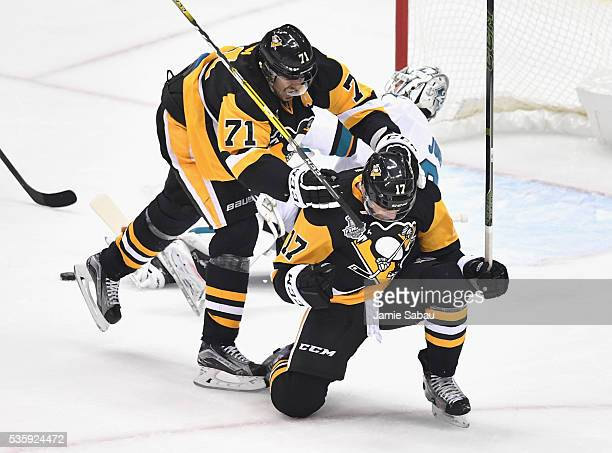 Bryan Rust of the Pittsburgh Penguins celebrates with Evgeni Malkin after scoring a first period goal against Martin Jones of the San Jose Sharks in...