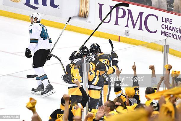 Bryan Rust of the Pittsburgh Penguins celebrates with Justin Schultz Evgeni Malkin and Ian Cole after scoring a first period goal against the San...