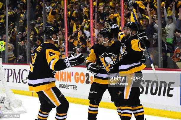 Bryan Rust of the Pittsburgh Penguins celebrates with teammates after scoring a goal against the Philadelphia Flyers in Game Five of the Eastern...