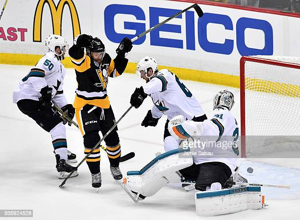 Bryan Rust of the Pittsburgh Penguins scores a first period goal against Martin Jones of the San Jose Sharks in Game One of the 2016 NHL Stanley Cup...