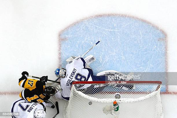 Bryan Rust of the Pittsburgh Penguins scores his second goal against Andrei Vasilevskiy of the Tampa Bay Lightning during the second period in Game...