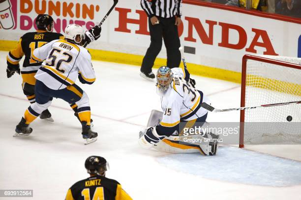 Bryan Rust of the Pittsburgh Penguins scores his team's second goal in the first period against Matt Irwin and goalie Pekka Rinne of the Nashville...