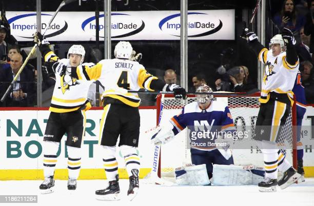 Bryan Rust of the Pittsburgh Penguins scores the game winning goal at 3:25 of overtime against the New York Islanders at the Barclays Center on...