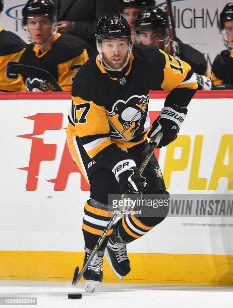 Bryan Rust of the Pittsburgh Penguins skates against the Vancouver Canucks at PPG Paints Arena on October 16 2018 in Pittsburgh Pennsylvania