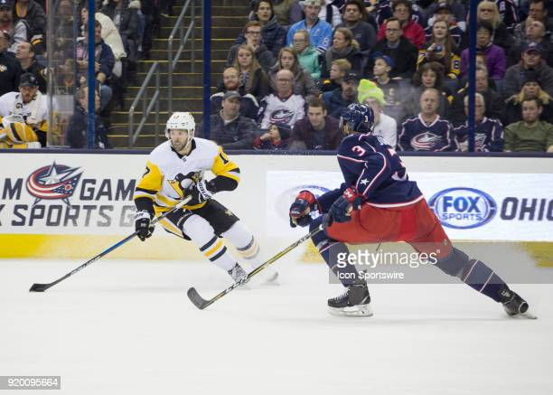 Bryan Rust of the Pittsburgh Penguins skates with the puck during second period of the game between the Columbus Blue Jackets and the Pittsburgh...