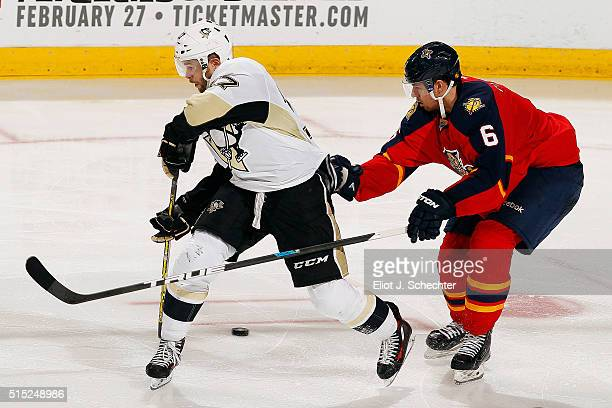 Bryan Rust of the Pittsburgh Penguins tangles with Alex Petrovic of the Florida Panthers at the BBT Center on February 6 2016 in Sunrise Florida