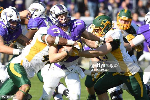 Bryan Schor of James Madison University is sacked by Jabril Cox and Caleb Butler of North Dakota State University The Division I FCS Football...
