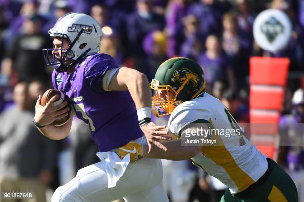 Bryan Schor of James Madison University is tackled by Caleb Butler of North Dakota State University The Division I FCS Football Championship is held...