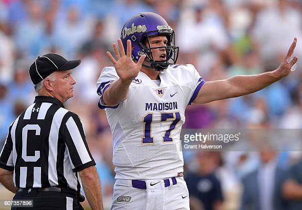 Bryan Schor of the James Madison Dukes calls for a timeout against the North Carolina Tar Heels during the game at Kenan Stadium on September 17 2016...
