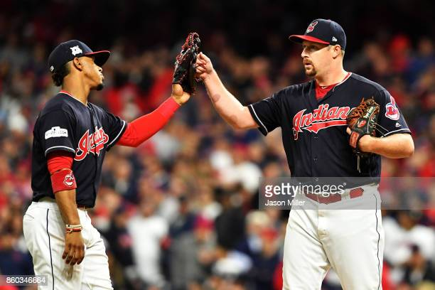Bryan Shaw of the Cleveland Indians celebrates with Francisco Lindor as he leaves the game in the eighth inning against the New York Yankees in Game...