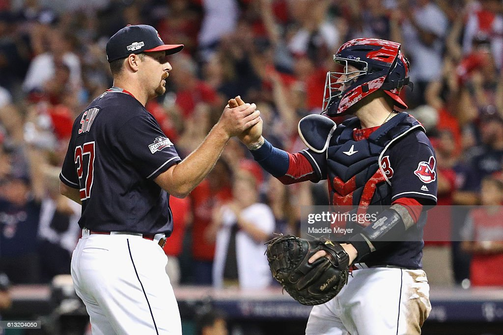 Bryan Shaw #27 of the Cleveland Indians celebrates with Roberto Perez #55 after defeating the Boston Red Sox 6-0 in game two of the American League Divison Series at Progressive Field on October 7, 2016 in Cleveland, Ohio.