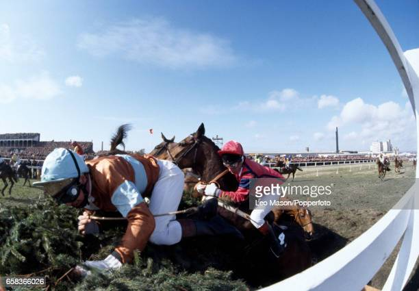 Bryan Smart riding Kintai is brought down followed by Bill Smith on The Champ which also fell at The Chair fence during the Grand National at Aintree...