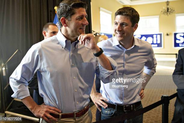 Bryan Steil a Republican US Representative candidate from Wisconsin right greets attendees with US House Speaker Paul Ryan a Republican from...