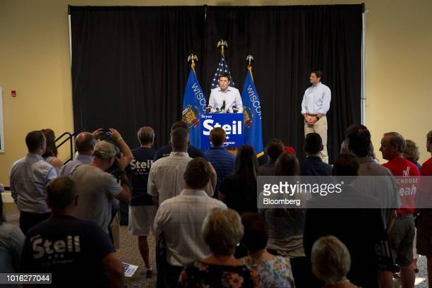 Bryan Steil a Republican US Representative candidate from Wisconsin center speaks as US House Speaker Paul Ryan a Republican from Wisconsin right...