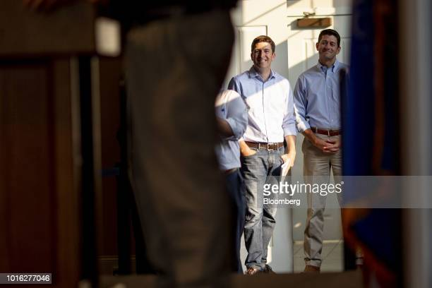 Bryan Steil a Republican US Representative candidate from Wisconsin center stands off stage with US House Speaker Paul Ryan a Republican from...