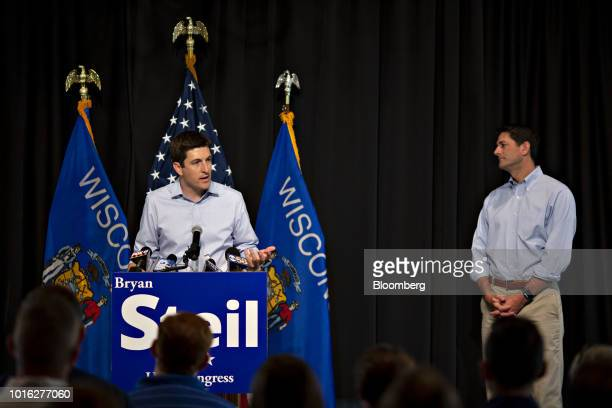 Bryan Steil a Republican US Representative candidate from Wisconsin left speaks as US House Speaker Paul Ryan a Republican from Wisconsin right...