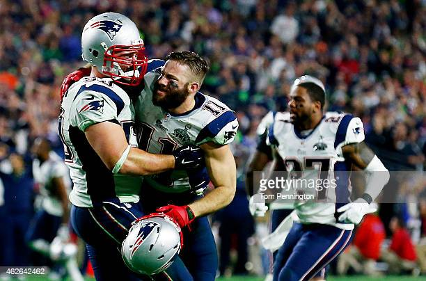 Bryan Stork and Julian Edelman of the New England Patriots celebrate an interception against the Seattle Seahawks late in the fourth quarter during...