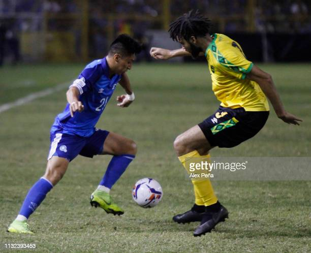 Bryan Tamacas of El Salvador battles for the ball with Michael Hector # of Jamaica during a match between El Salvador and Jamiaca as part of the...