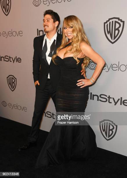 Bryan Tanaka and recording artist Mariah Carey attend the 19th Annual PostGolden Globes Party hosted by Warner Bros Pictures and InStyle at The...
