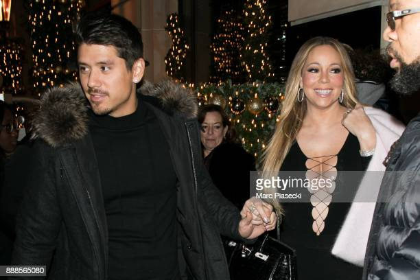 Bryan Tanaka and singer Mariah Carey are seen leaving the Royal Monceau hotel on December 8 2017 in Paris France