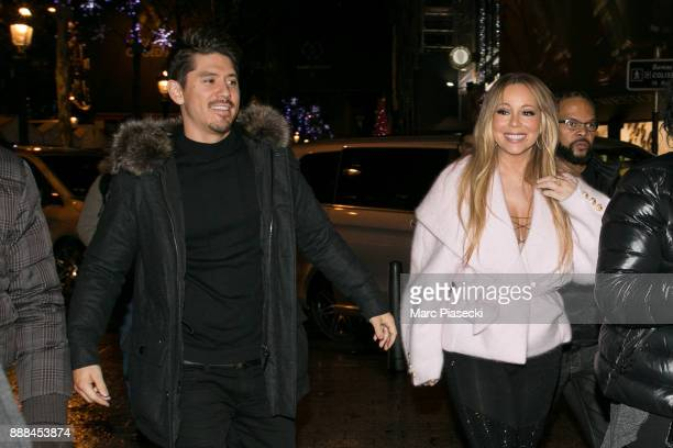 Bryan Tanaka and singer Mariah Carey are seen on ChampsElysees Avenue on December 8 2017 in Paris France